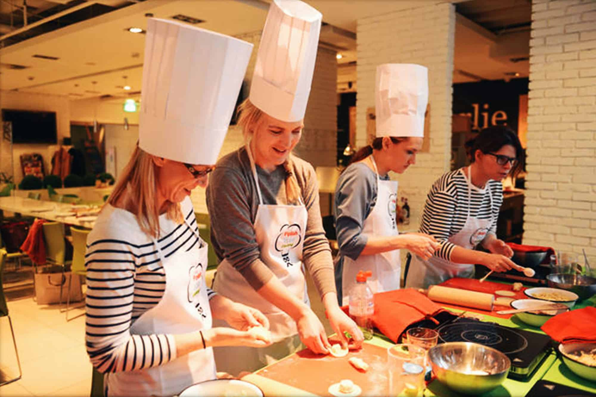 People learning cooking skills the polish way
