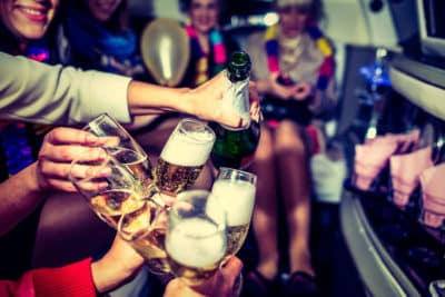 Bachelorette girls party open a bottle in the limo in Warsaw