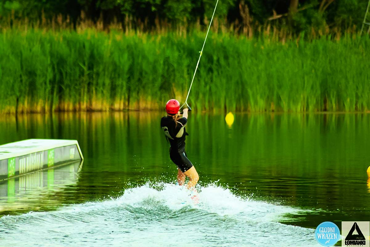 Random person trying skills at wakeboard in Dziekanow lesny next to Warsaw