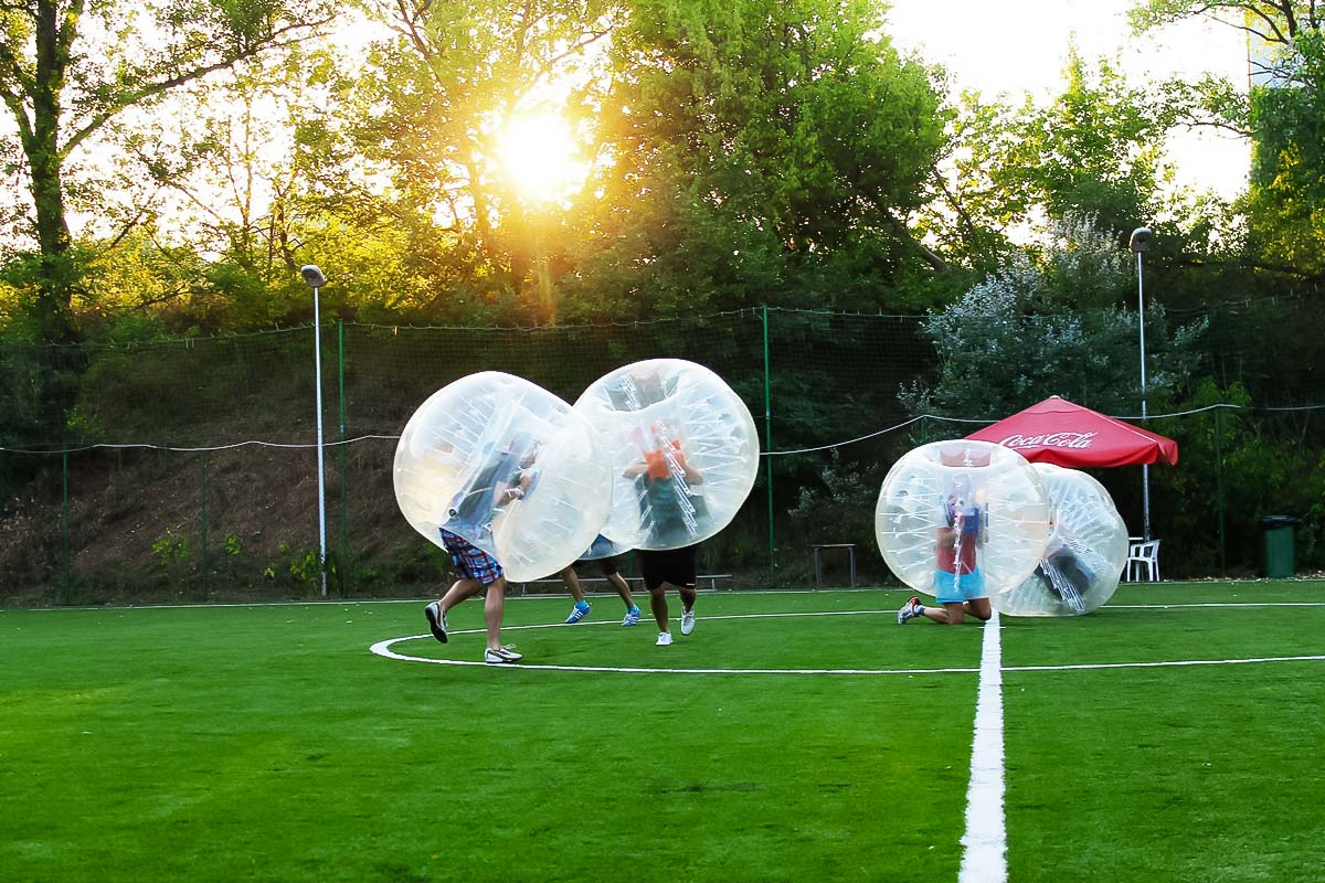 Bubble football in Warsaw during the sunset
