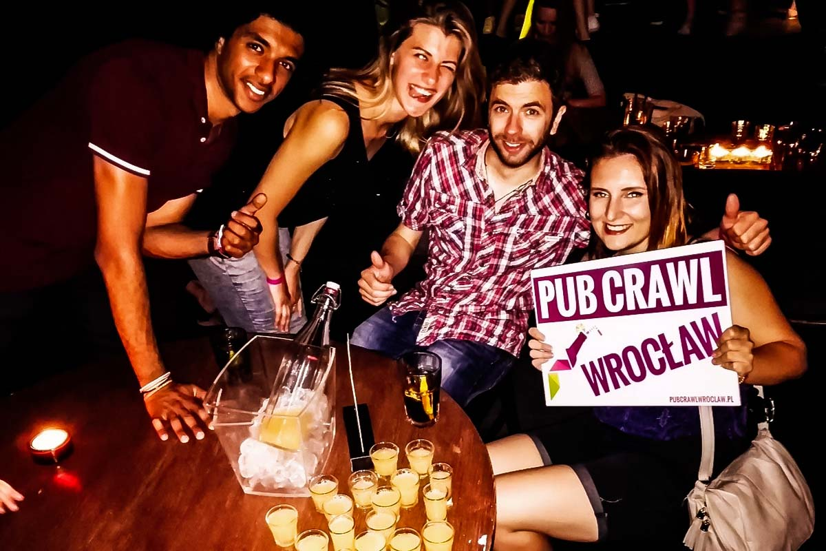 Fun group having some shots in one of the bars on the route of the Wroclaw Pub Crawl