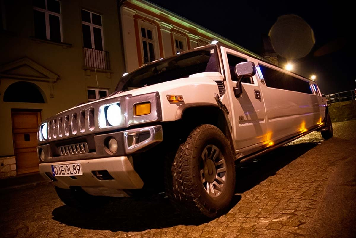 Airport pickup at Krakow Balice airport in a stylish Hummer Limousine