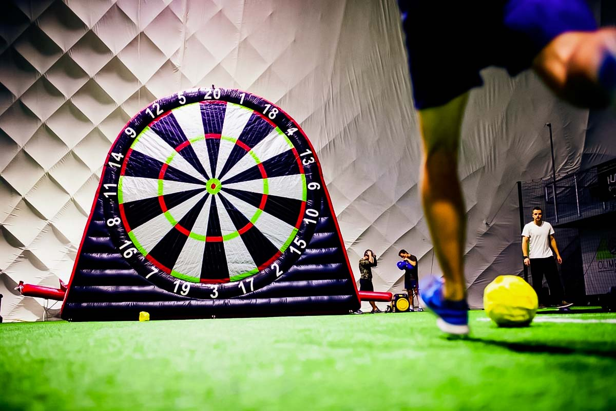 A guy kicking the ball during Football Darts