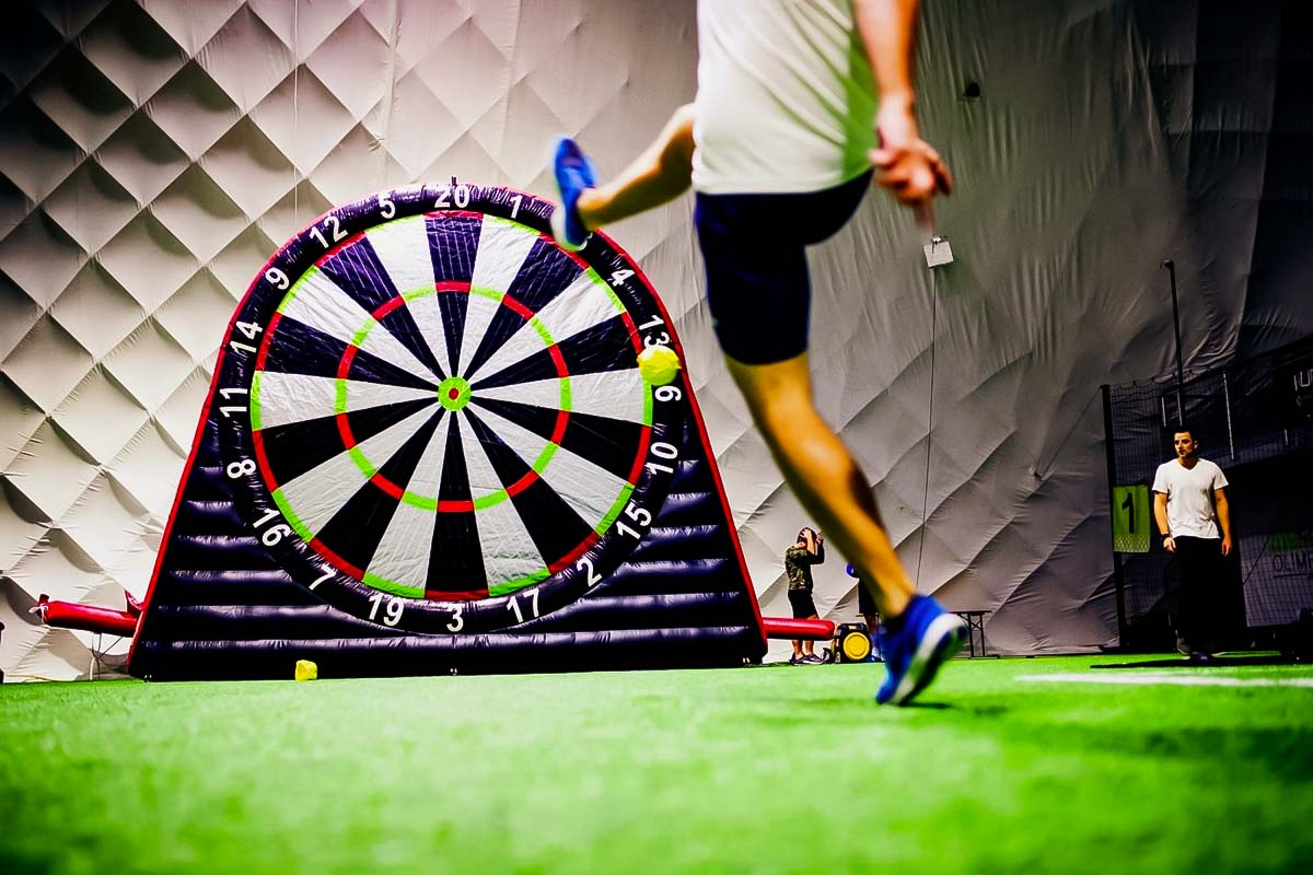 A man kicking the ball in football darts