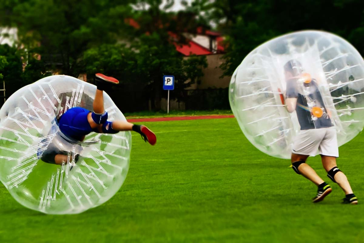 Have fun with friends on a bachelor party in Poznan playing crazy match of bubble football