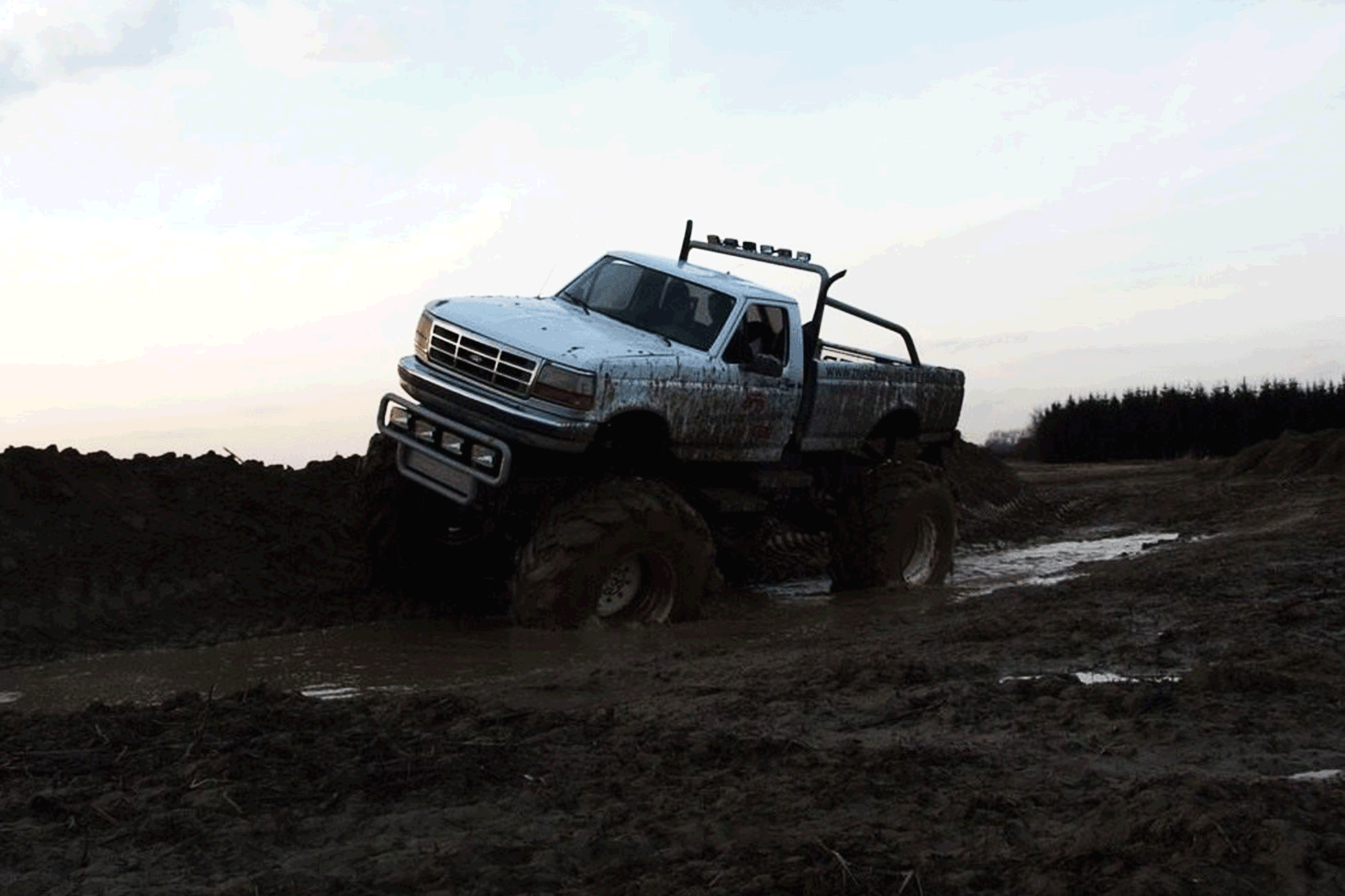 Monster Truck on mud during the sunset in Warsaw