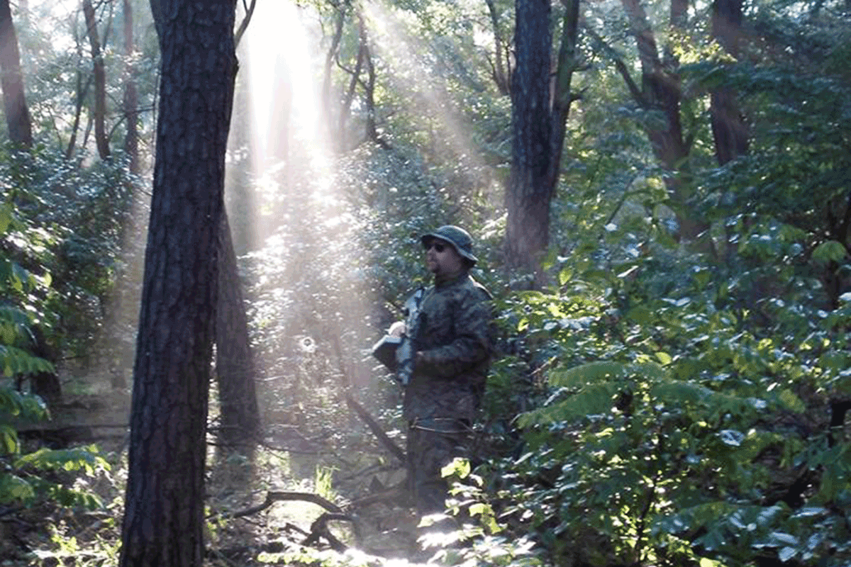 One of the participants in the forest in poznan during the airsoft game