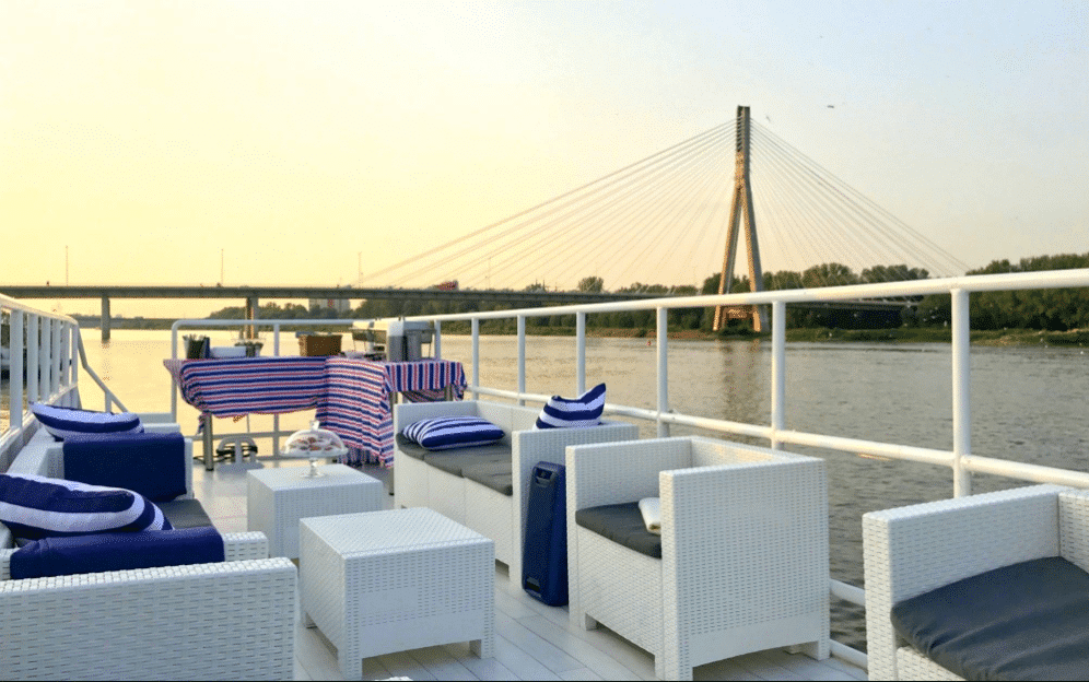 party boat in warsaw sunset